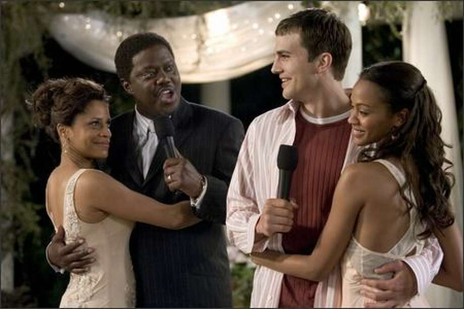 Percy Jones (Bernie Mac, second left) takes great pride in the knowledge that he is always right, especially when it comes to the welfare of his family. When his daughter Theresa (Zoe Saldana, right) brings her new boyfriend, Simon Green (Ashton Kutcher), home to meet Percy and his wife Marilyn (Judith Scott, left), he is unaware that Simon has already proposed to Theresa and plans to announce the engagement at Percy and Marilyn's 25th anniversary party. Photo: Columbia Pictures