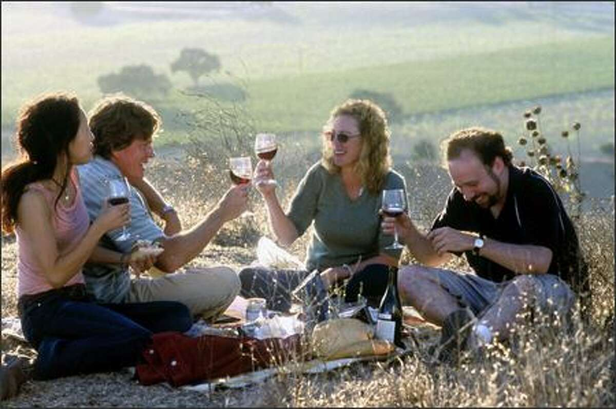 They soon find themselves drowning in wine and women (Sandra Oh, far left, and Virginia Madsen, second from right). Emerging from a haze of pinot noir, wistful yearnings and trepidation about the future, the two inevitably collide with reality.