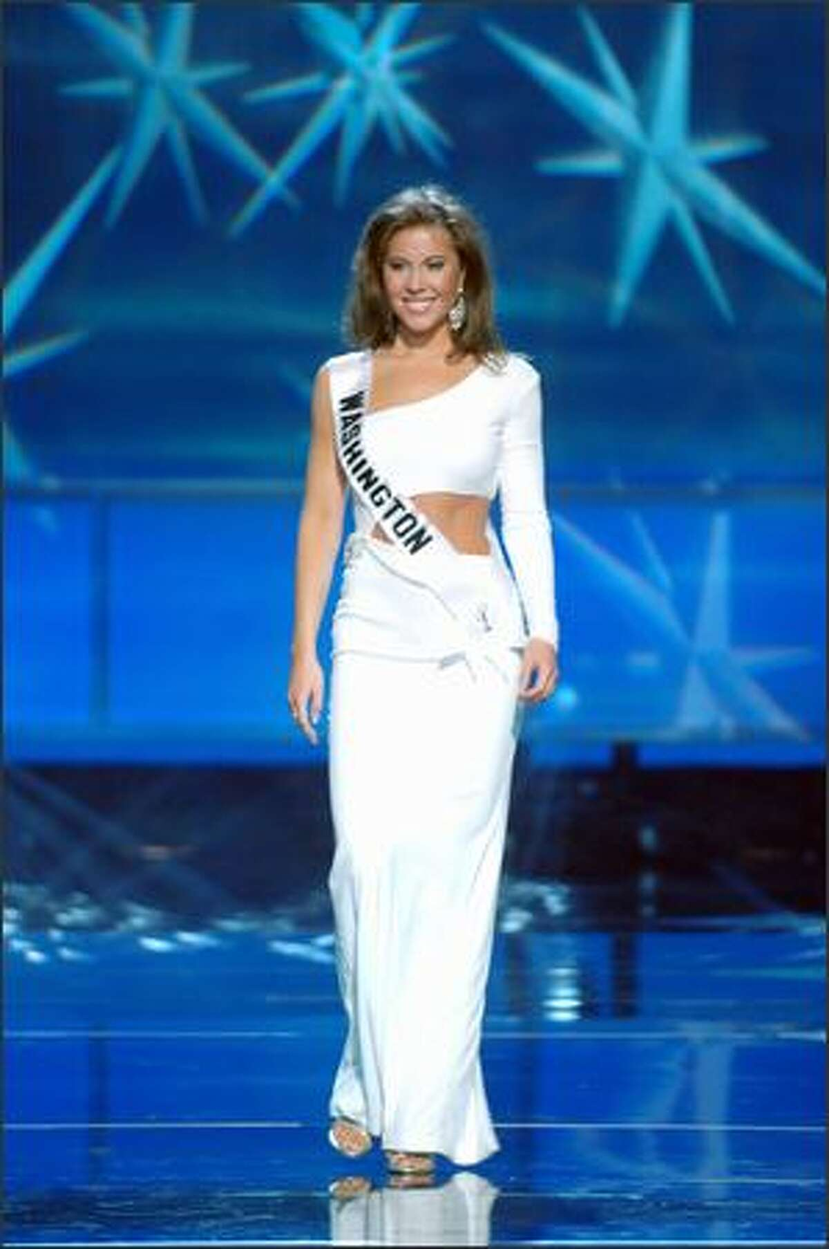 Amy Crawford, Miss Washington, competes in an evening gown of her choice during the Miss USA 2005 Presentation Show in Baltimore, Md., on Wednesday. Crawford, 25, a five-time runner-up in two different pageants before being crowned Miss Washington USA last November, is a singer and account representative for a local medical skin-care company. The pageant finals are Monday night.