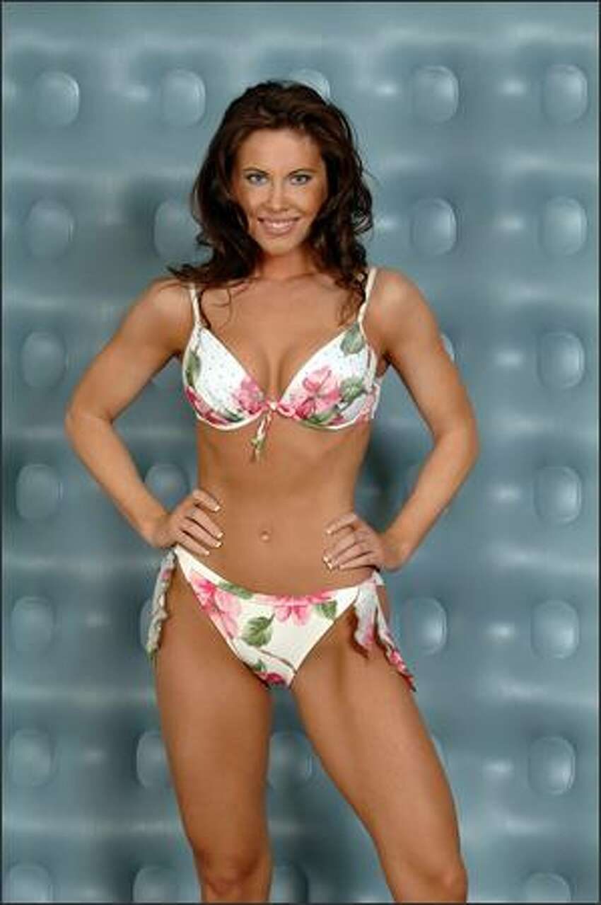 Amy Crawford poses in swimwear during registration and fittings on March 26. Crawford lists