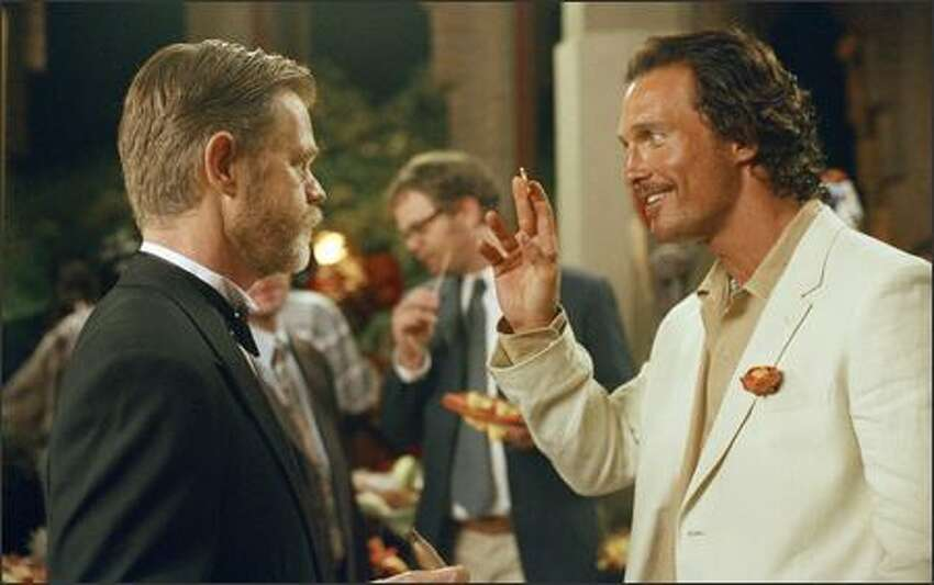 When Dirk Pitt (Matthew McConaughey, right) finds a fabled coin, his boss, Admiral Sandecker (William H. Macy, left), gives Dirk permission to hunt for a historical legend.