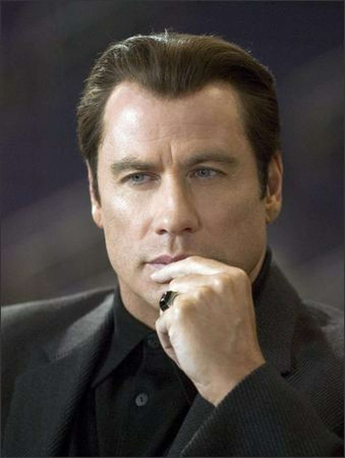 John Travolta stars as Chili Palmer, the same character he played in