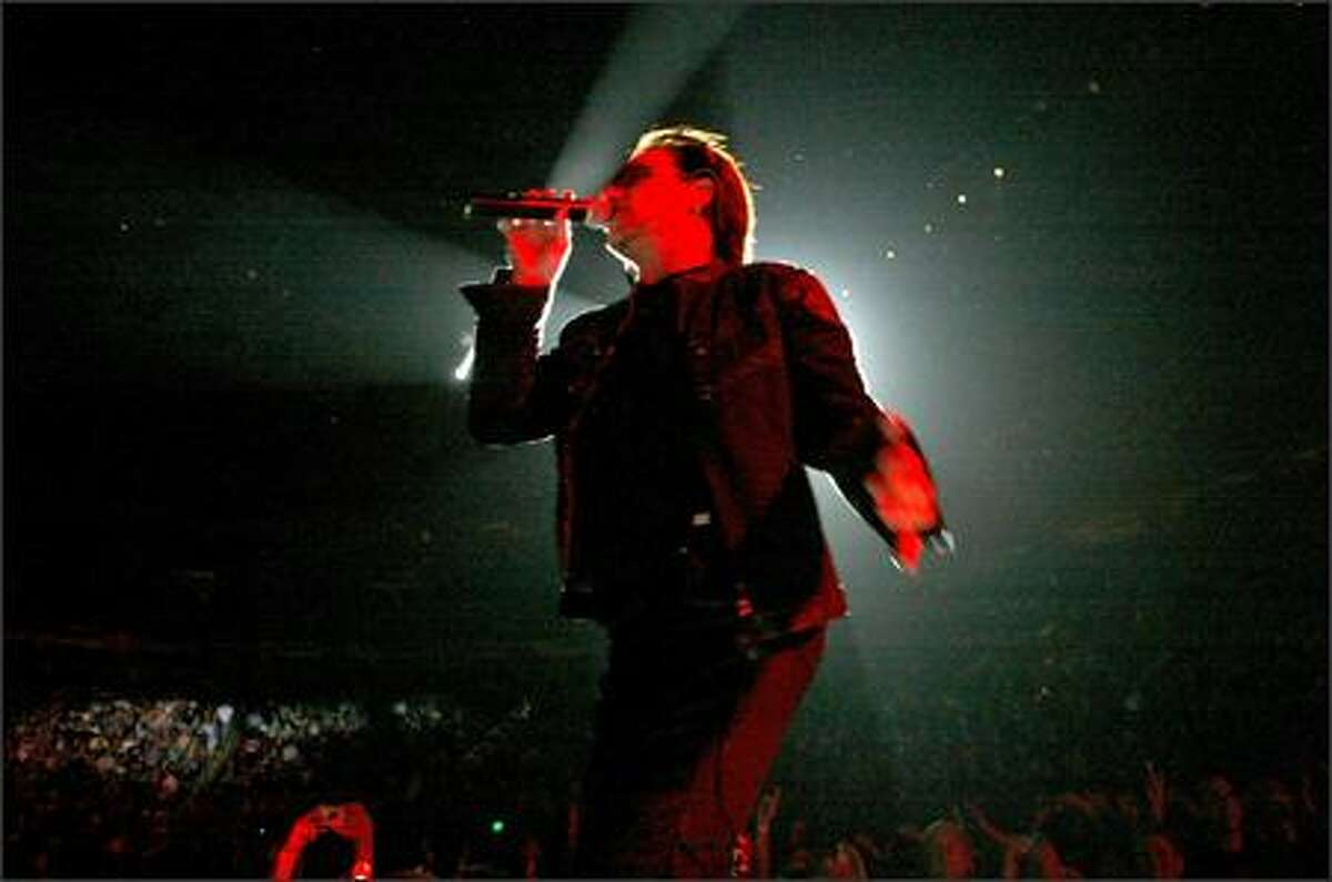 Bono belts out the opening song at KeyArena.