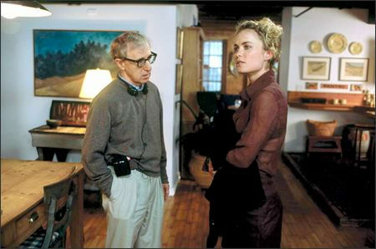 """In """"Melinda and Melinda,"""" legendary filmmaker Woody Allen (left, here with title character Radha Mitchell) has chosen to return to his signature work -- an ensemble piece populated by accomplished, artistic, occasionally neurotic men and women living in modern day New York whose lives become increasingly complicated."""