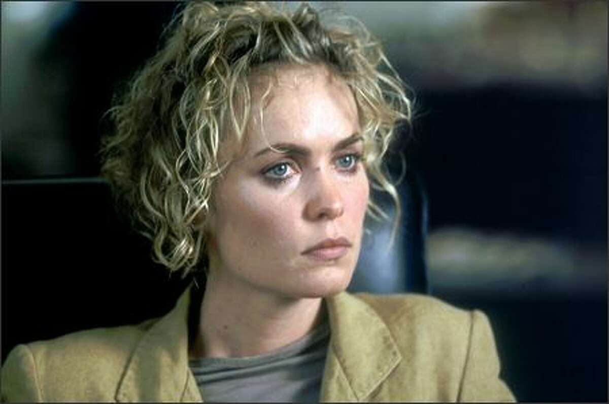 A twist is introduced in the film's opening scene, in which four sophisticated New Yorkers enjoy a dinner out on a rainy night. An anecdote provokes a discussion between two writers about the dual nature of human drama. Ultimately a comic tale unfolds, pitted against a more dramatic version of itself -- both centered on a somewhat enigmatic woman named Melinda (Radha Mitchell).