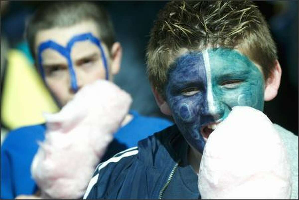 Mariners fans Shahar Levari, 11, left, and Albert Williams, 11, enjoy cotton candy at Safeco Field.