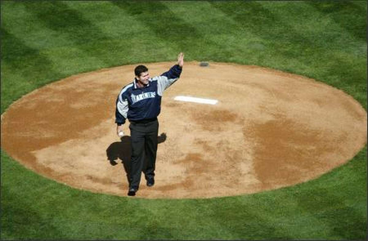 Former Mariner Edgar Martinez waves to adoring fans before throwing out the first pitch during opening day festivities at Safeco Field.