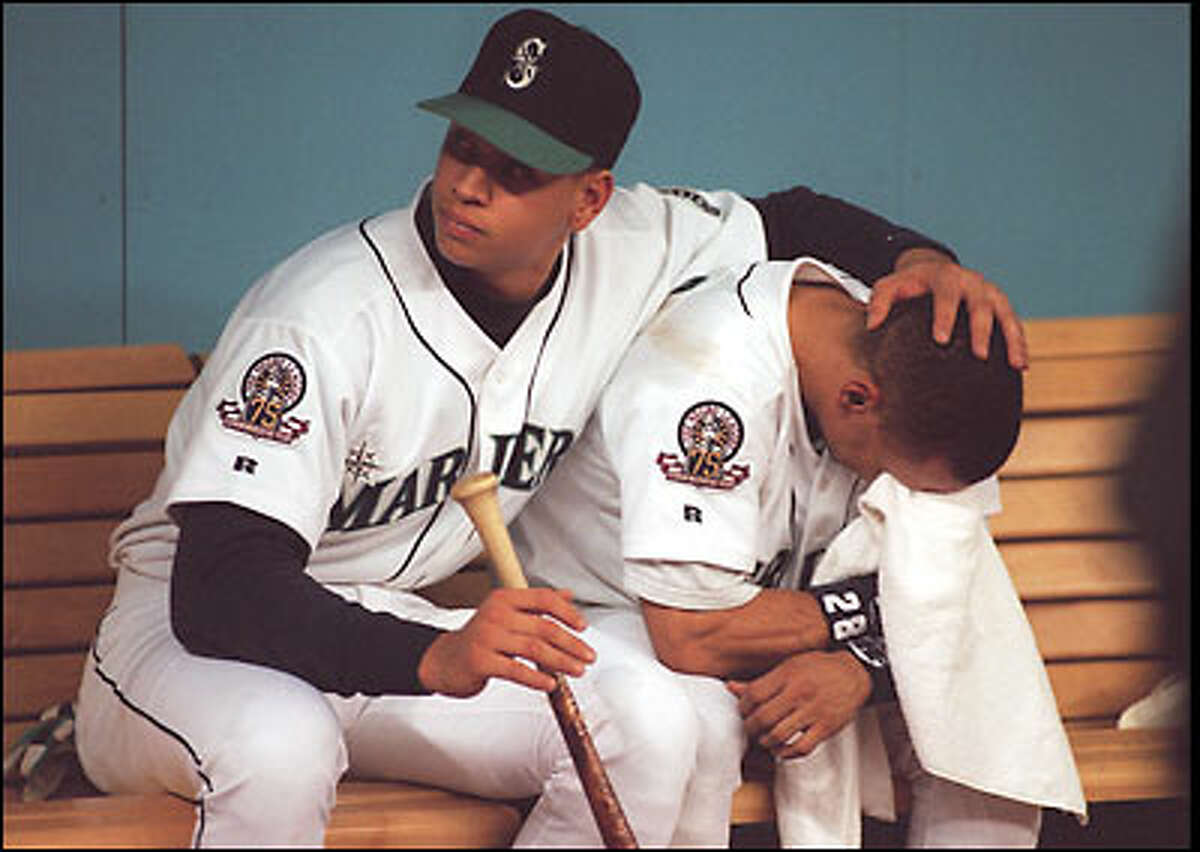1995: Alex Rodriguez comforts distraught teammate Joey Cora after the Mariners are eliminated from the American League Championship Series by the Cleveland Indians.