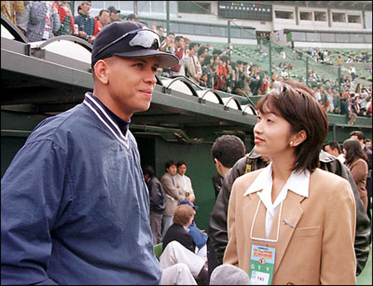 1996: Alex Rodriguez, winner of the 1996 Associated Press player of the year, gets an interview from Yumiko Fukushima, a Japanese TV reporter, before a goodwill game against a Japanese all-star team at Seibu Lions Stadium in a suburb of Tokyo.