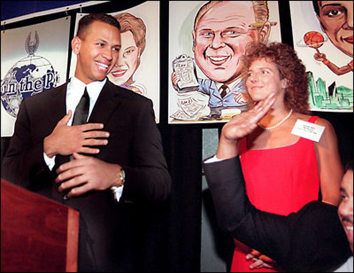1997: Alex Rodriguez and U.S soccer star Michelle Akers share the podium after receiving their awards as P-I sports stars of the year.