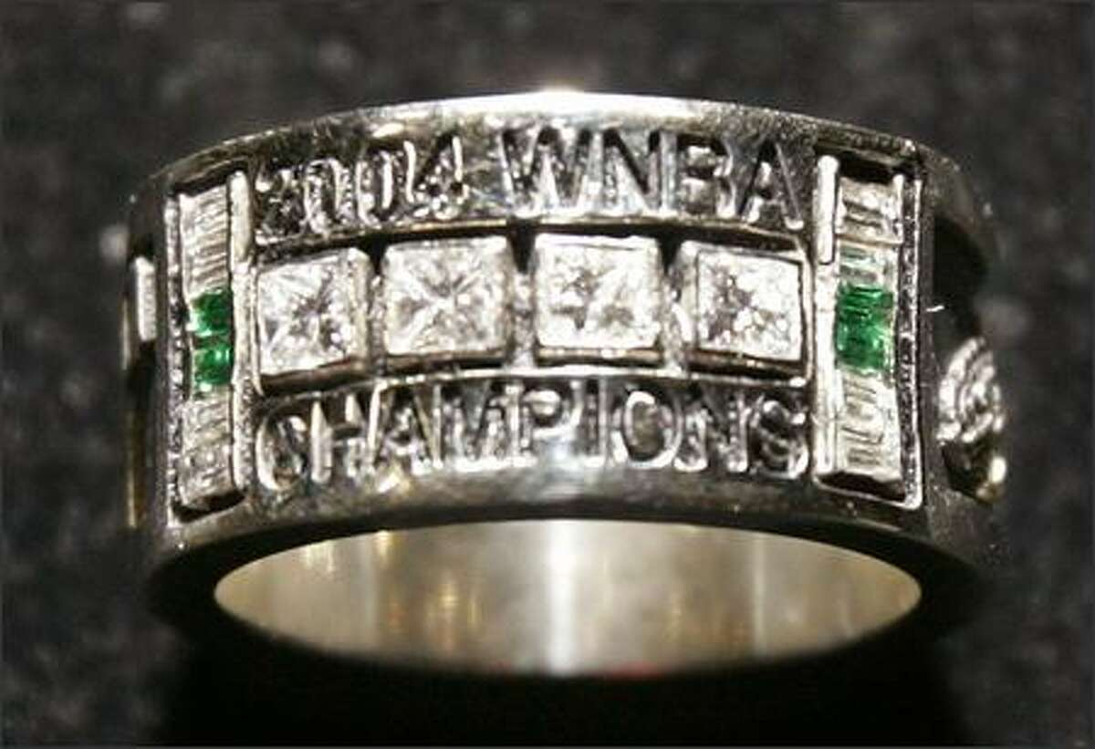 A 2004 WNBA championship ring belonging to a Seattle Storm player is displayed after the team's season-opening game. The players were presented with the rings before the game and a championship banner was raised to the ceiling. The Sparks won, 68-50. (AP Photo/Elaine Thompson)