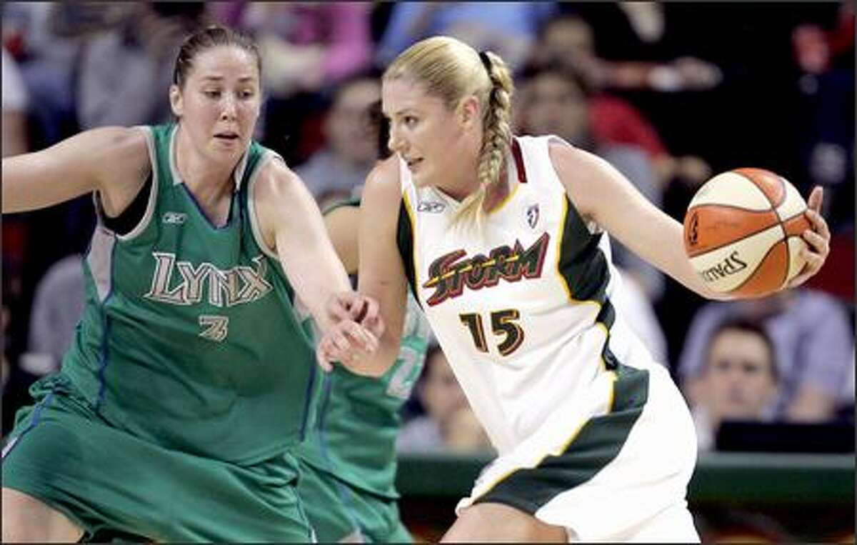 The Storm's Lauren Jackson, right, tries to drive past Minnesota's Nicole Ohlde in the first half.