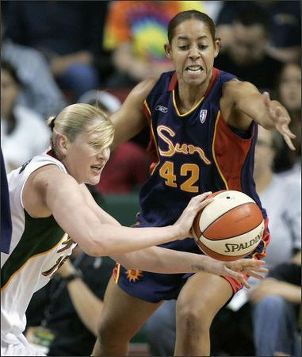 Lauren Jackson, left, passes as Connecticut's Nykesha Sales tries to defend in the first half. (AP Photo/Elaine Thompson)