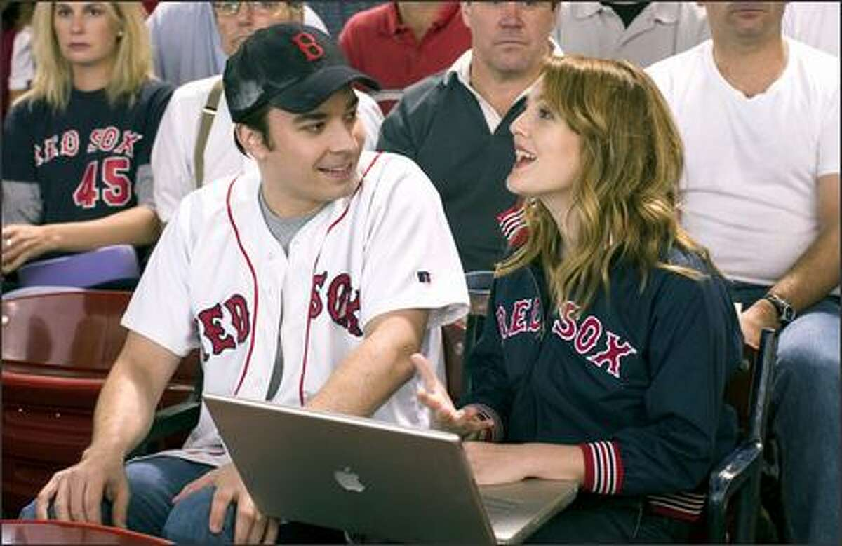 """Lindsey (Drew Barrymore) tries to juggle work and """"fun"""" while attending a Red Sox game with boyfriend Ben (Jimmy Fallon)."""