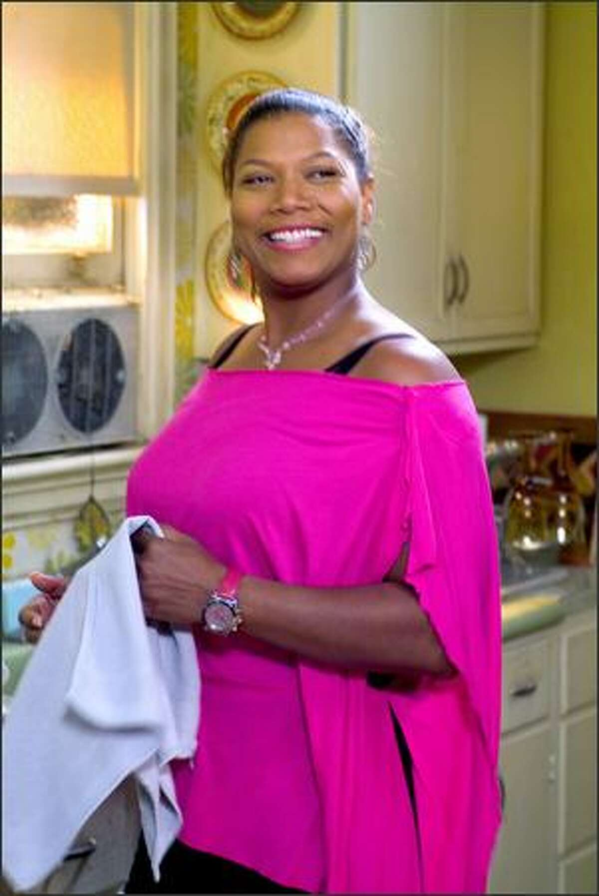 Queen Latifah plays Gina Norris, a hair stylist who risks it all to buy a rundown beauty shop in Atlanta.