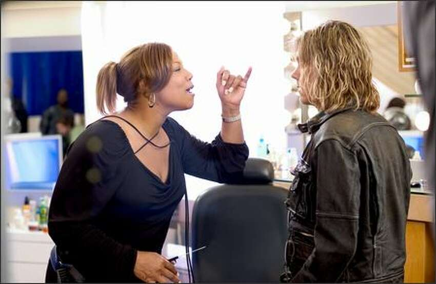 Gina (Queen Latifah) gives Jorge (Kevin Bacon) a piece of her mind. Jorge plays her egotistical boss. Gina eventually quits to start her own business.