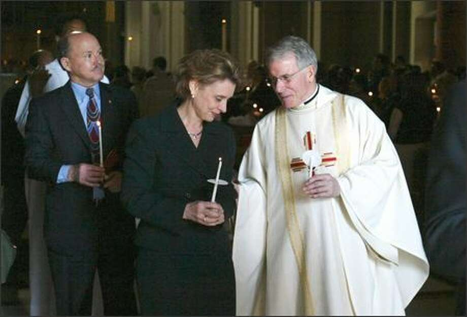 "The Very Rev. Michael Ryan, pastor of St. James Cathedral, pictured with then-Gov. Chris Gregoire:  ""What happens when the moral imperatives of God's Word -- and our deeply held beliefs as Christians -- are at odds with positions espoused by our elected leaders?""  Photo: Meryl Schenker, Seattle Post-Intelligencer"
