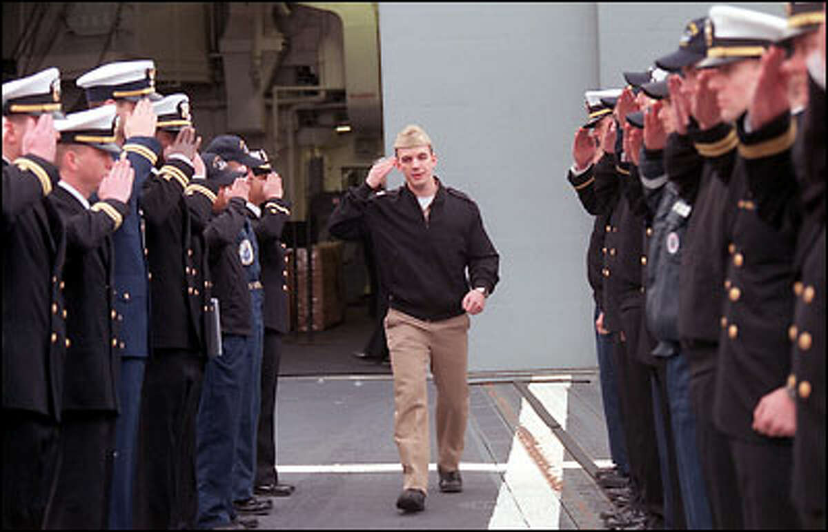Lt. Nathan Schneider salutes officers as he leaves the USS Paul F. Foster, happy to be returning stateside. The ship was en route to the Persian Gulf for a six-month deployment.