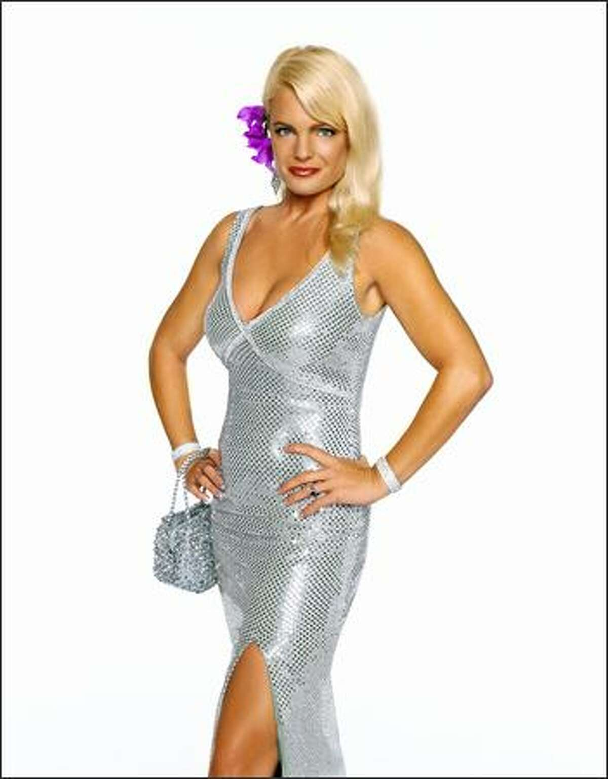 The other Ginger this season is Erika Eleniak. Best-known for her two seasons on