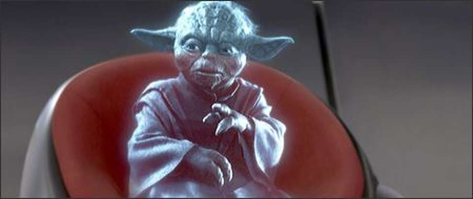 A hologram of Jedi master Yoda reports in to the Jedi ...