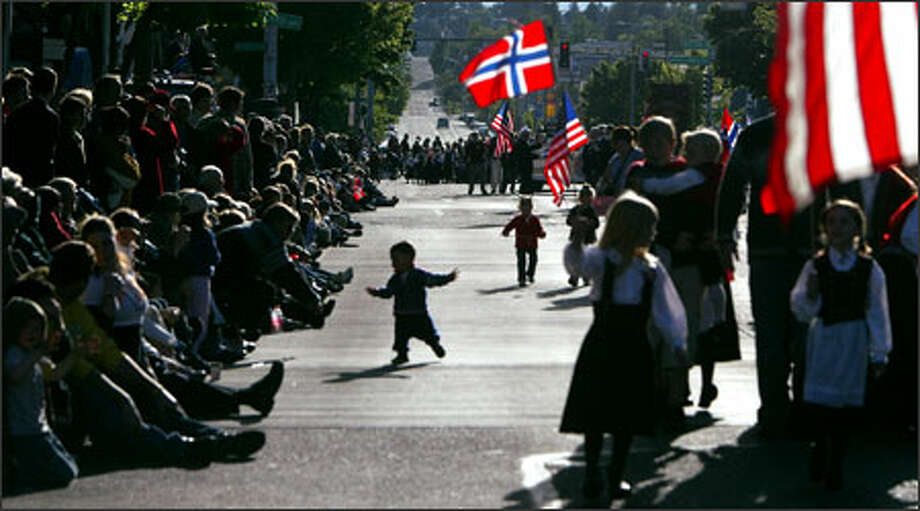 Ballard's Market Street was packed during the Norwegian Constitution Day Parade. This year's parade marked the 100th anniversary of Norway's independence. Photo: Karen Ducey, Seattle Post-Intelligencer / SEATTLE POST-INTELLIGENCER