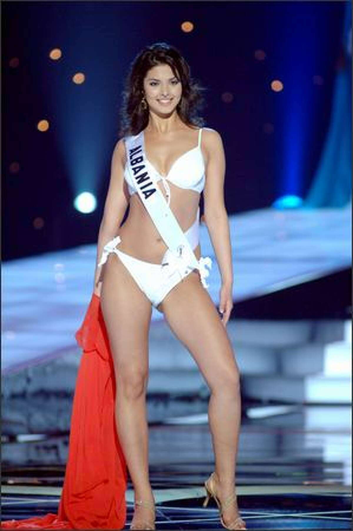 Agnesë Vuthaj, Miss Albania, competes in her BSC Swimsuit and Nina Shoes during the 2005 Miss Universe Presentation Show at Impact Arena, Exhibition and Convention Center in Bangkok, Thailand on May 26. During the presentation show, each contestant was judged by a preliminary panel of six judges in swimsuit and evening gown categories, after two days of one-on-one interviews. The scores will be tallied and the top 15 contestants will be announced during Monday's telecast (NBC, tape-delayed to 9 p.m. PDT), at the conclusion of which a winner will be crowned.