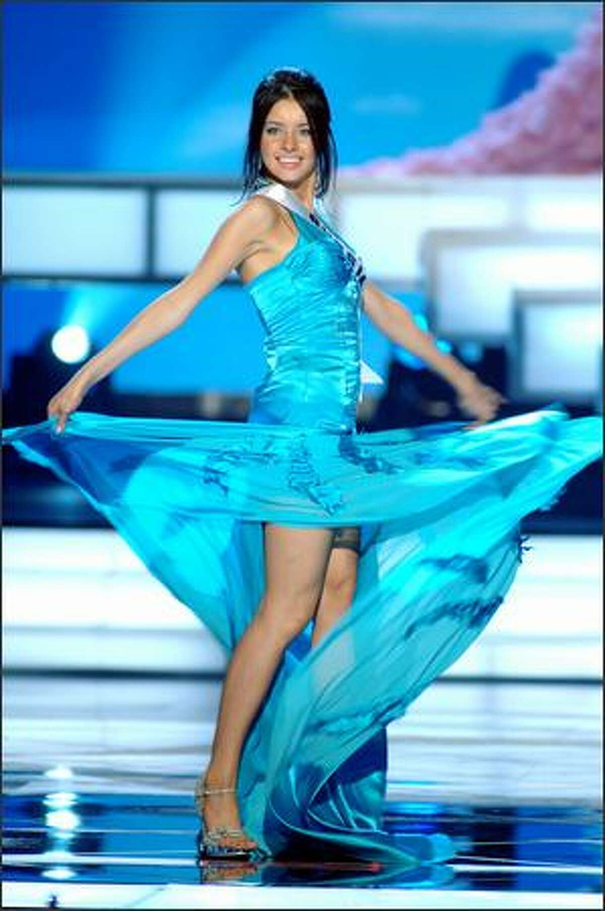 Natalia Nikolaeva, Miss Russia, competes in an evening gown of her choice during the 2005 Miss Universe Presentation Show at Impact Arena, Exhibition and Convention Center in Bangkok, Thailand on May 26. During the presentation show, each contestant was judged by a preliminary panel of six judges in swimsuit and evening gown categories, after two days of one-on-one interviews. The scores will be tallied and the top 15 contestants will be announced during Monday's telecast (NBC, tape-delayed to 9 p.m. PDT), at the conclusion of which a winner will be crowned.