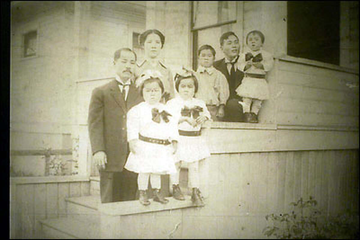 Takuji Yamashito and his wife, Ito, with five of their six children. Denied the right to practice law, he managed restaurants and hotels to support his family.