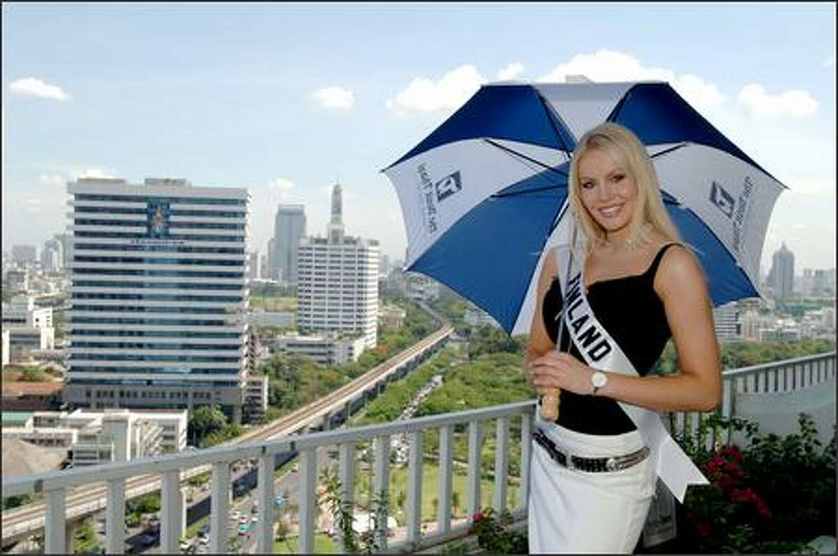 Hanna Ek, Miss Finland, poses at the Dusit Thani Hotel in Bangkok. Ek, like many of the contestants, is a college student who also models professionally. Her country has won the pageant twice, most recently in 1975.