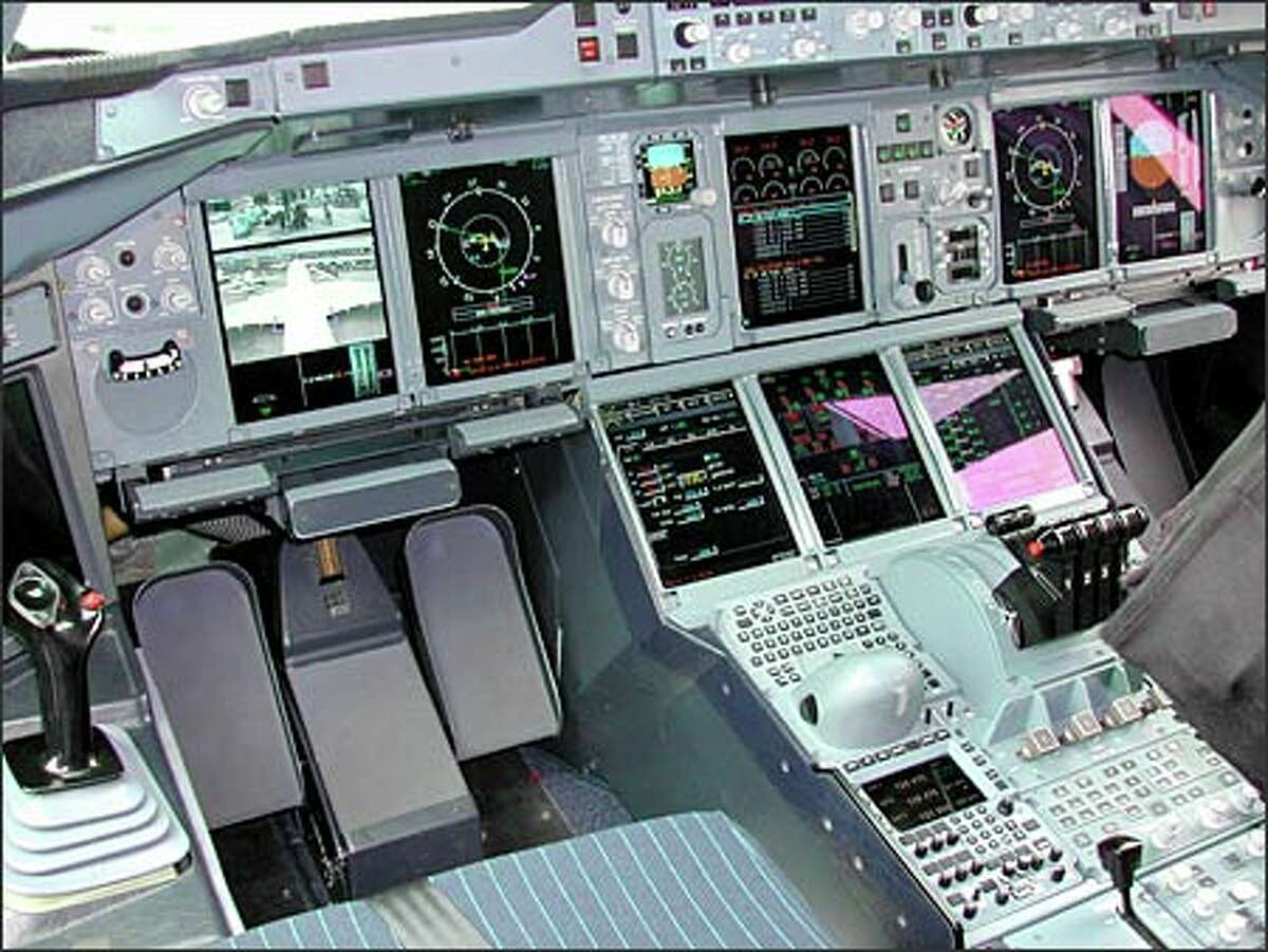 Here's the cockpit of the A380. At left is the joy stick, which in all Airbus planes replaces the more traditional yoke. On screen in front of the pilot's position are views from some of the 35 on-board cameras on the plane. The top view is the scene underneath the aircraft. The bottom view is from a camera mounted on the plane's vertical tail.