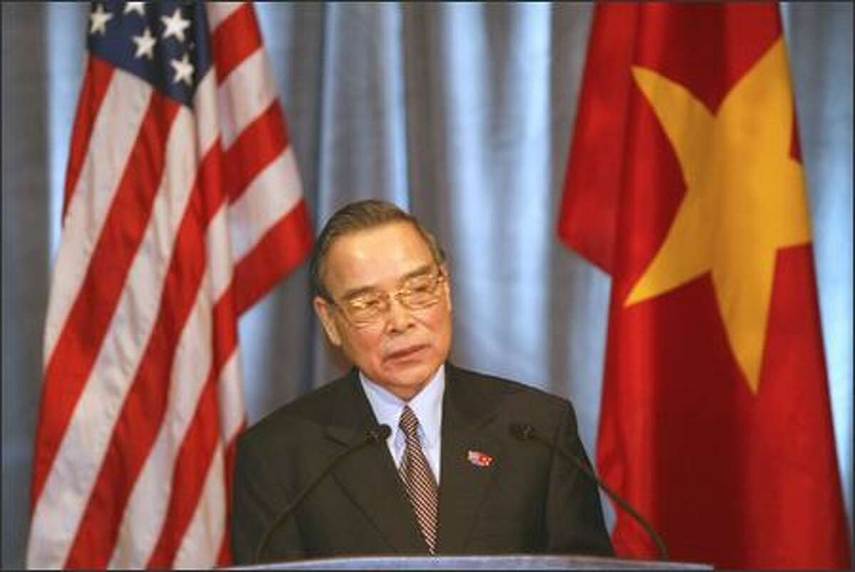 Prime Minister Phan Van Khai of Vietnam speaks to the press at the Fairmont Olympic Hotel.