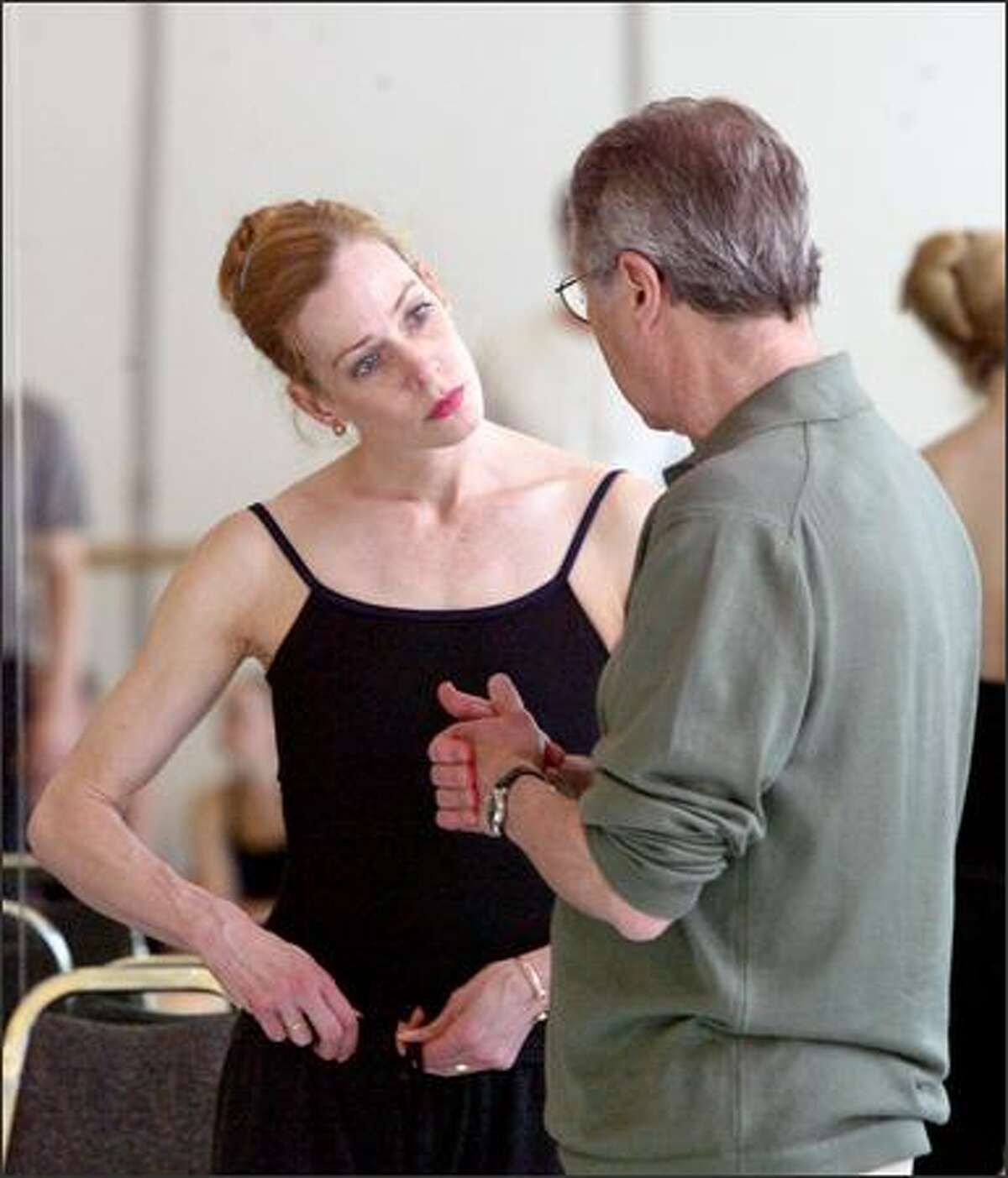 Principal dancer Patricia Barker listens to directions from Kent Stowell during a rehearsal for