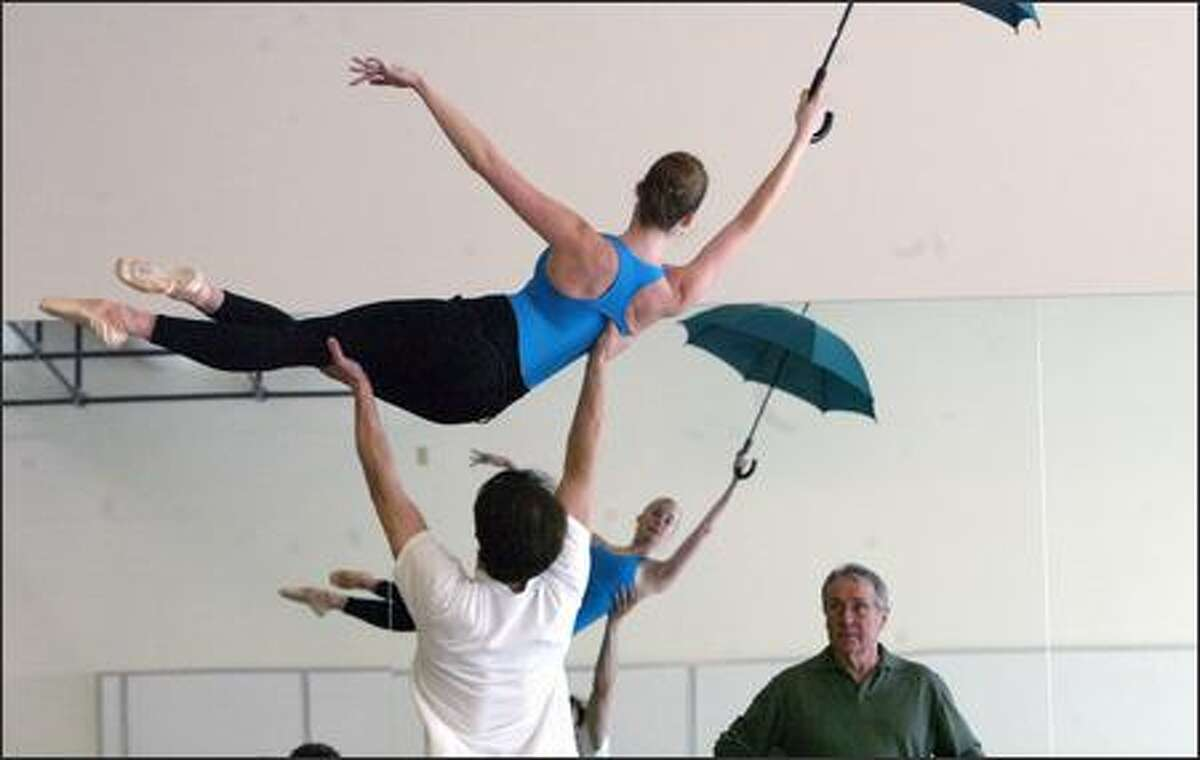 Departing PNB director Kent Stowell watches a rehearsal with dancers Kylee Kitchens and Cristophe Maraval.