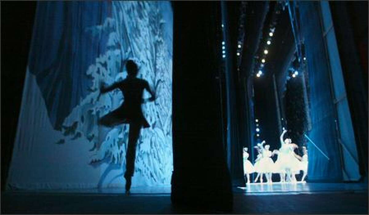 Dancer Noelani Pantastico practices backstage while dancers perform the snow scene from