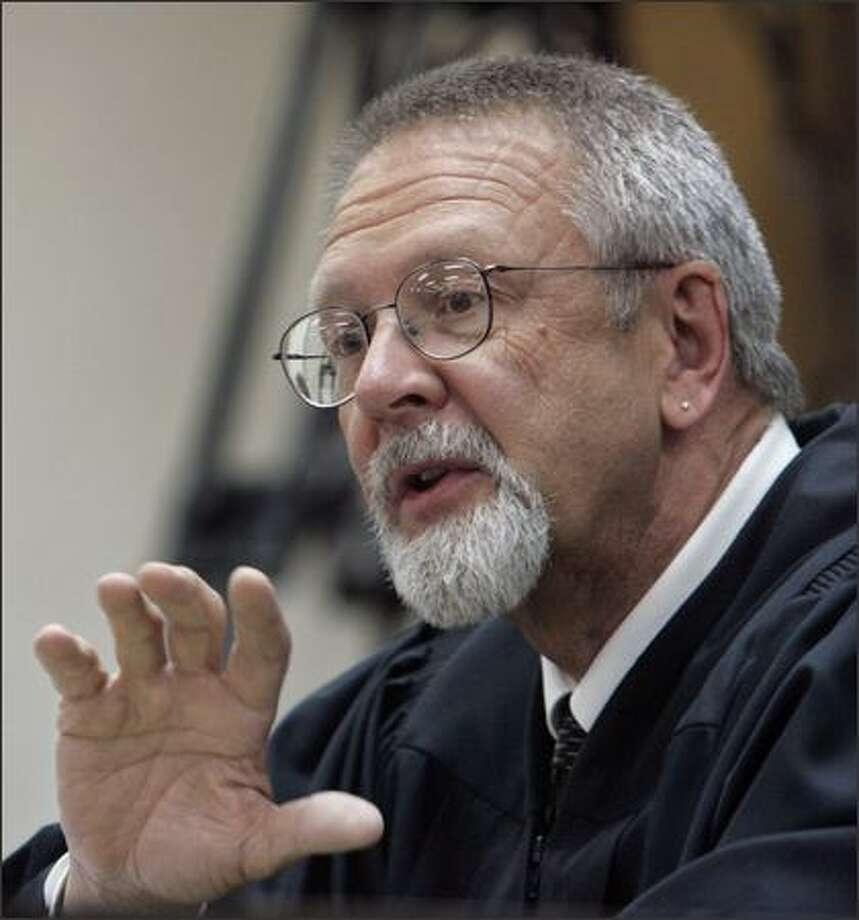 Judge John Bridges announces his verdict in the gubernatorial election challenge in Chelan County Superior Court  Monday  in Wenatchee. Bridges upheld Washington's 2004 gubernatorial election. (AP Photo/Elaine Thompson) Photo: Associated Press