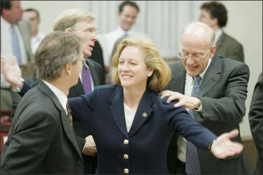 Attorneys representing the Democratic Party in Washington state celebrate Judge John E. Bridges' ruling. From left are, Kevin Hamilton, Russell Speidel, Jenny Durkan and David McDonald.(AP Photo/The Wenatchee World, Kelly Gillin)