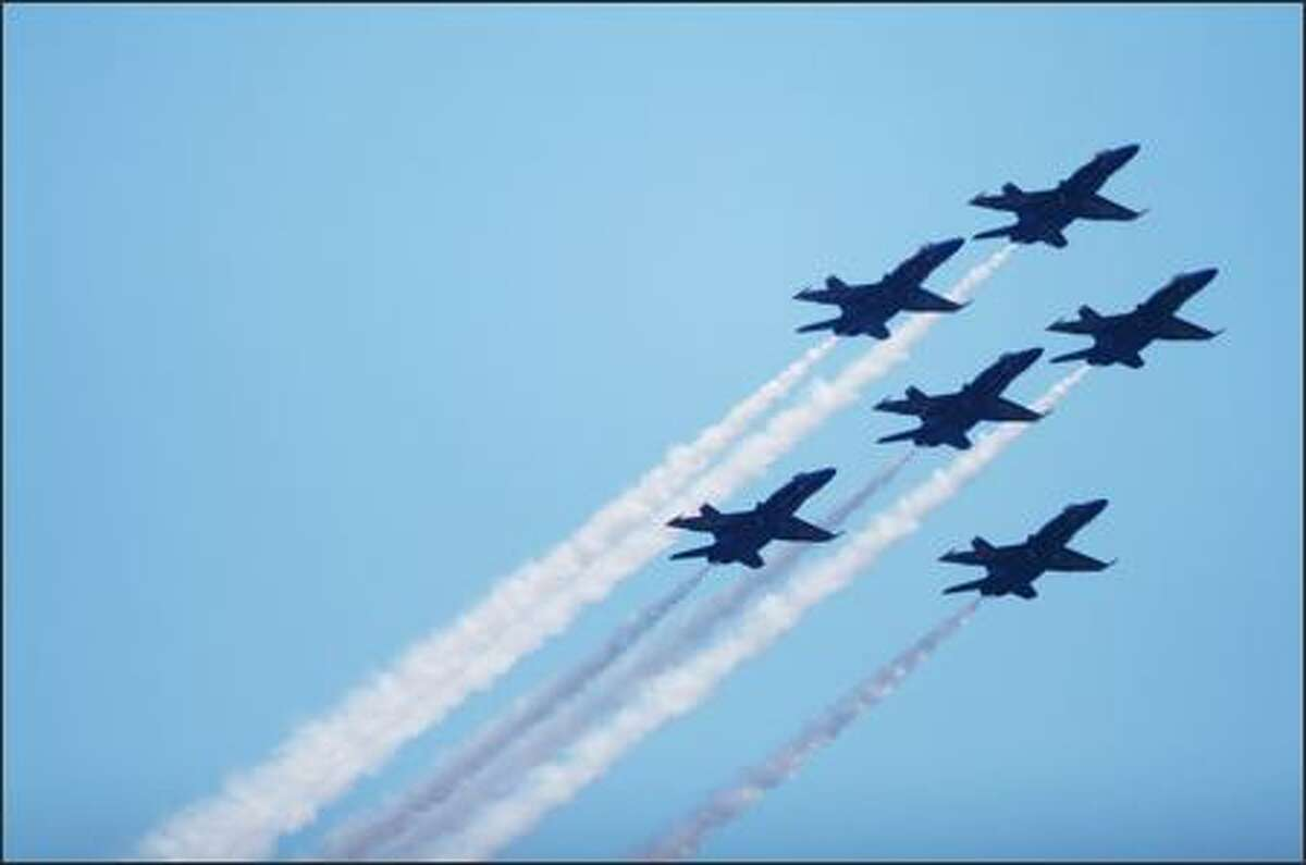 The Navy's Blue Angels fly in formation at the start of the Seafair Airshow over Lake Washington Saturday.