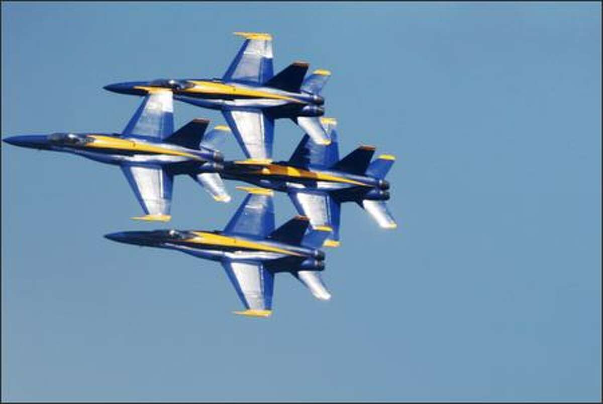 Four Blue Angels fly in tight formation over Lake Washington during the Seafair Airshow Saturday.