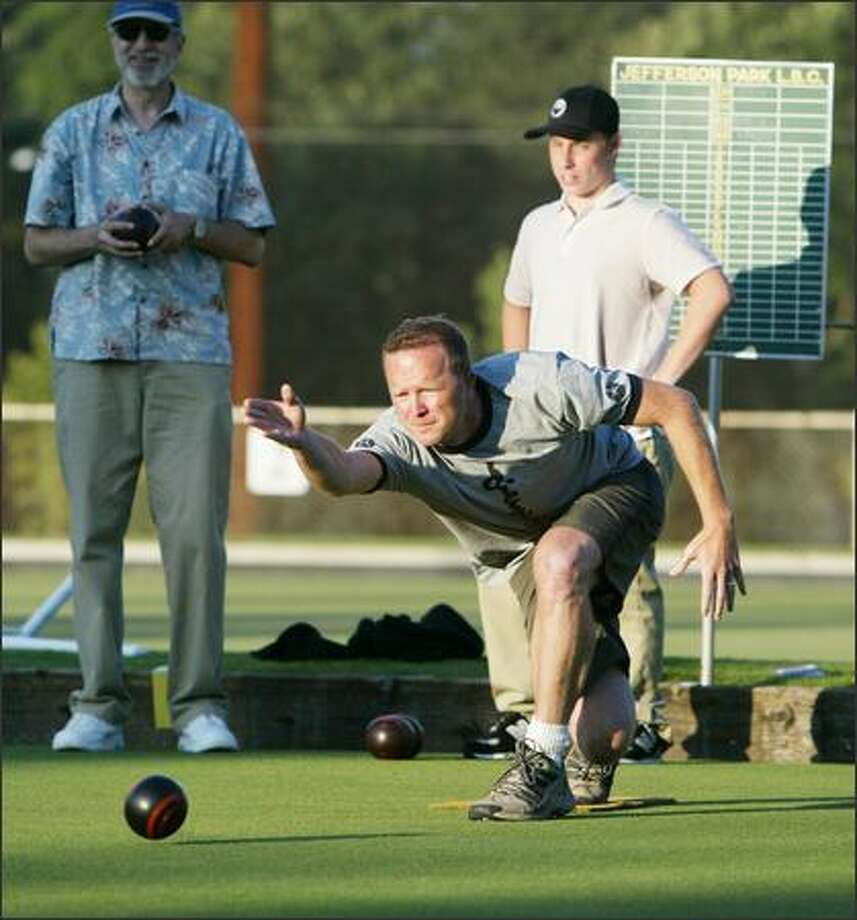 Pete Smith lets loose his bowl as  Gene Freedman (left) and Harry Jamieson watch during an Aug. 2 match.  Lawn Bowling is dying in the U.S. But at Jefferson Park Lawn Bowling Club on Beacon Hill in Seattle, the sport is making a comeback among younger folks, as evidenced by a men's lawn bowling league called Men With Big Bowls that competes on Tuesday nights. Jamieson, for example, is 17 and going into his senior year at Garfield High School. Photo: Scott Eklund, Seattle Post-Intelligencer