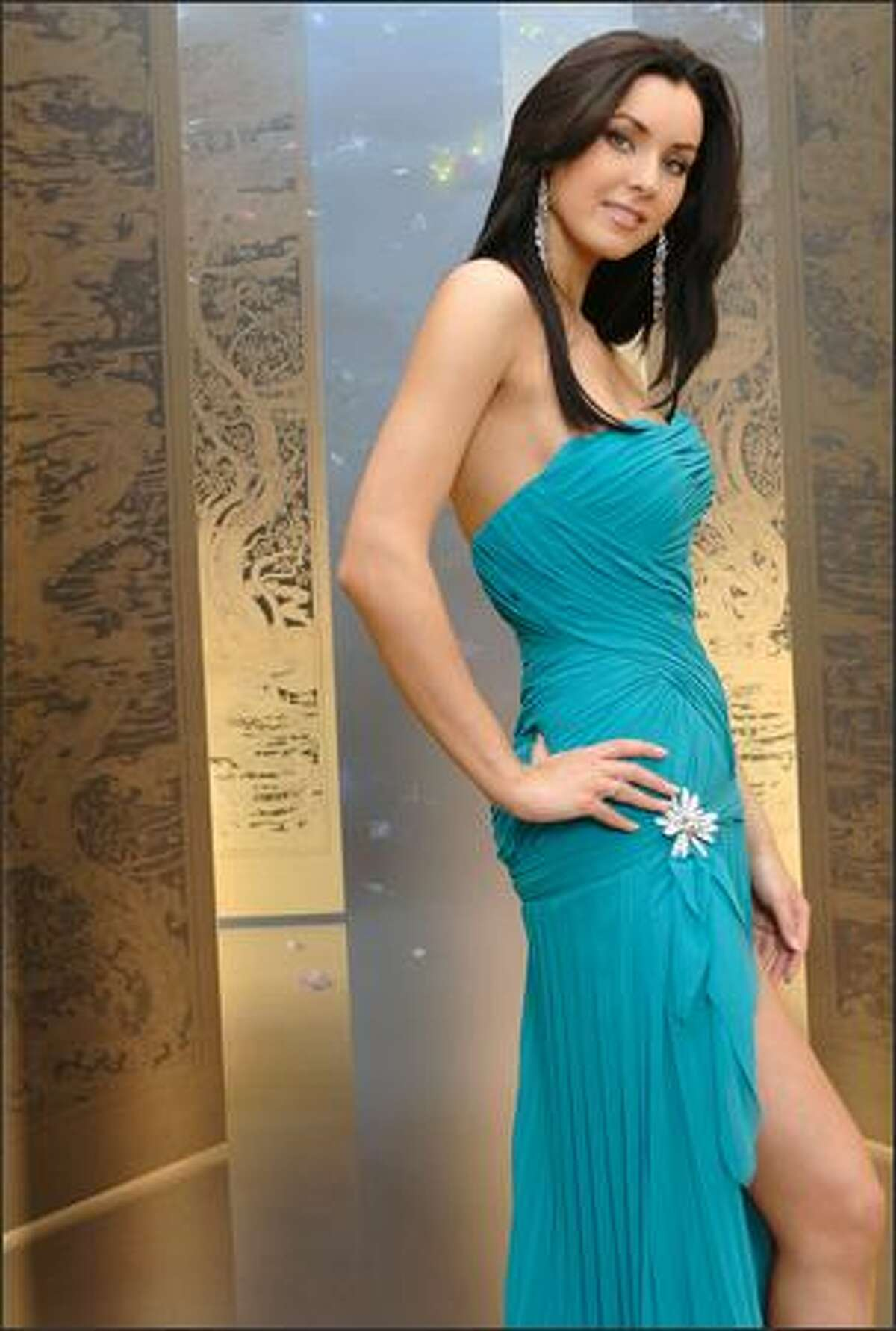Natalie Glebova, Miss Canada, poses in an evening gown at the Devarana Spa at the Dusit Thani hotel during registration and fittings for the Miss Universe 2005 competition in Bangkok, Thailand on May 11.
