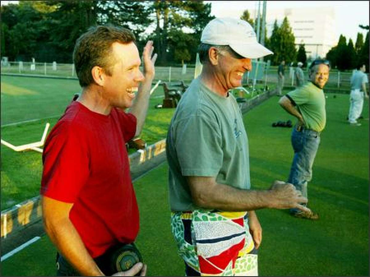 Buddies Willie Weir (left) and David Branch laugh between bowls as they compete against each other Aug. 2. Weir started the men's league, called Men With Big Bowls, to keep in better touch with his friends.