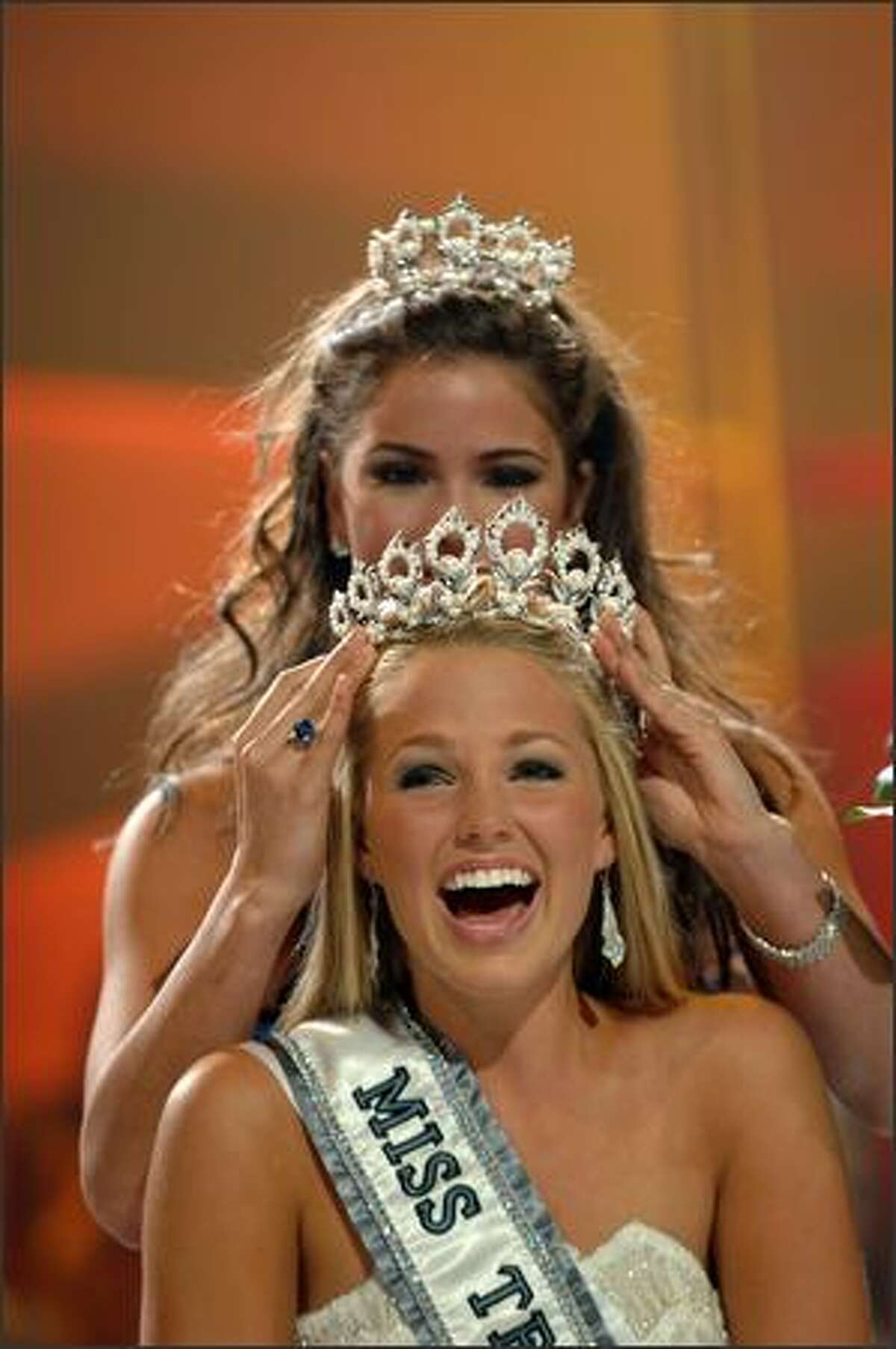 Allie LaForce reacts while being crowned Miss Teen USA 2005 by Shelley Hennig, Miss Teen USA 2004.