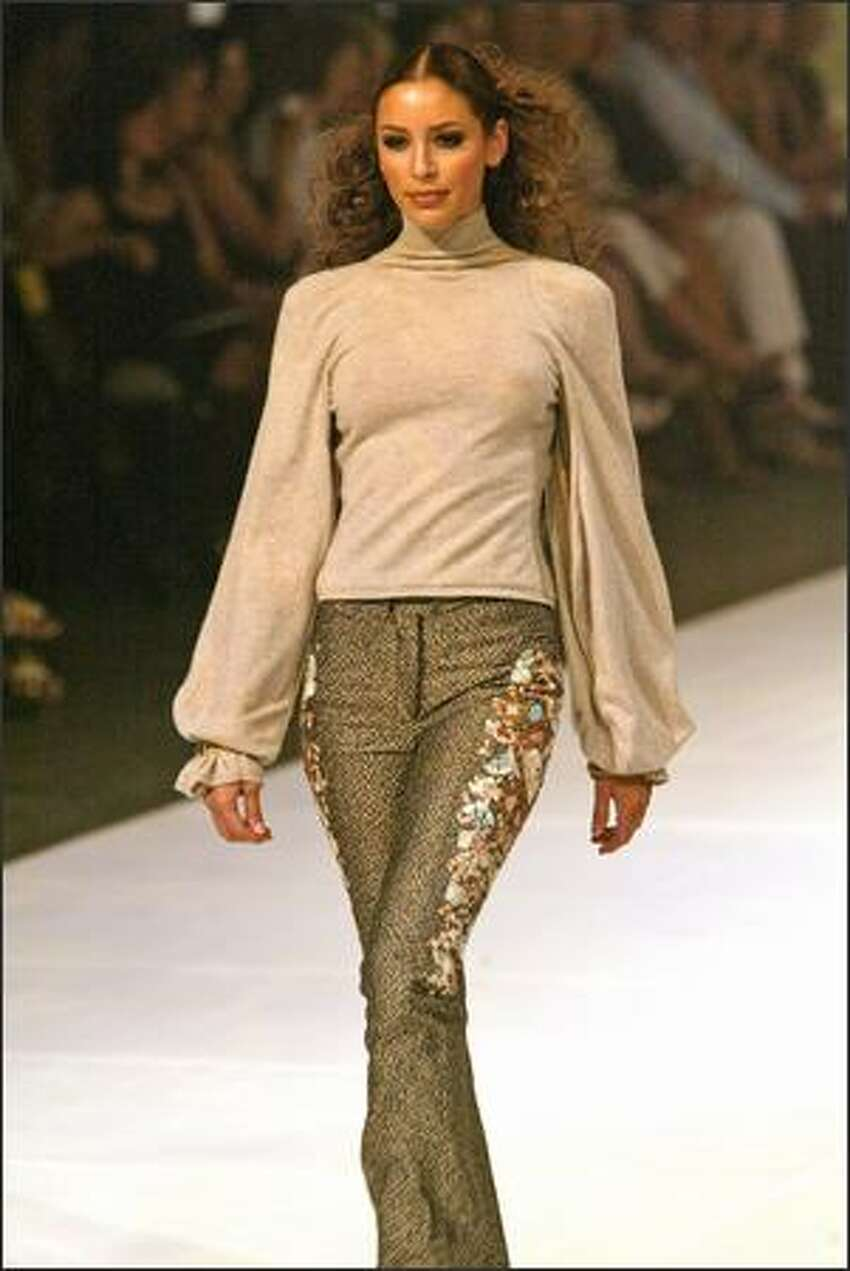 ZAC POSEN COLLECTION: Oatmeal cashmere admiral turtleneck with billow sleeves. Tan embroidered