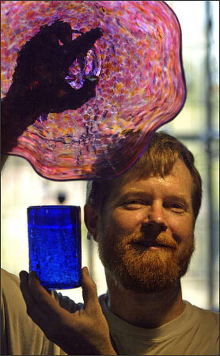 Glass blower David Smith at his studio in Ballard, Blowing Sands Glass Studio.