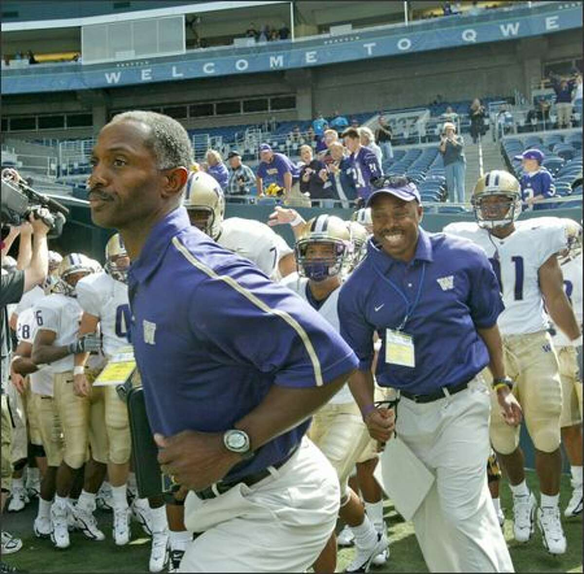 UW head coach Tyrone Willingham leads the Huskies onto the field for his first game.