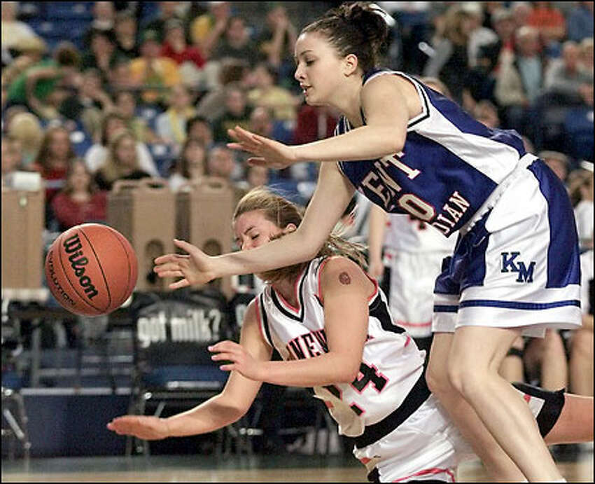 Kennewick's Autumn Fielding, left, battles for a loose ball with Kent-Meridian's Ane Tuivai. Fielding scored eight points in the Lions' victory.