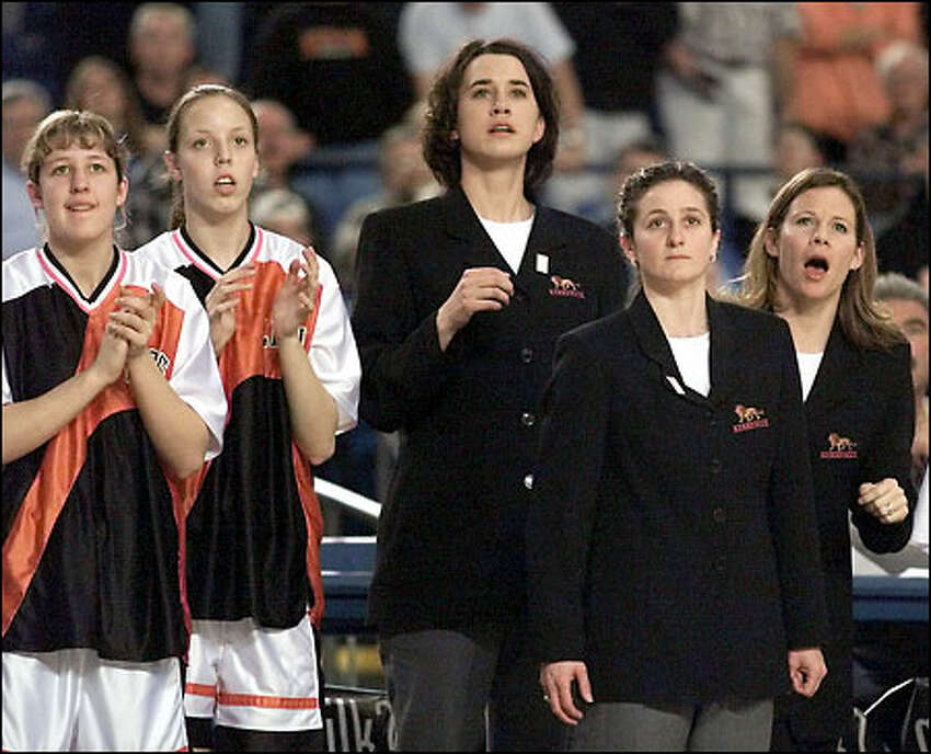 Kennewick coach, Debbie Roueche, second from right, and her team watch as they come back and tie the score with minutes left in the game. Kennewick came back from an eight point defecit with six minutes left to win the game 50-48 against the Kent-Meridian Royals.