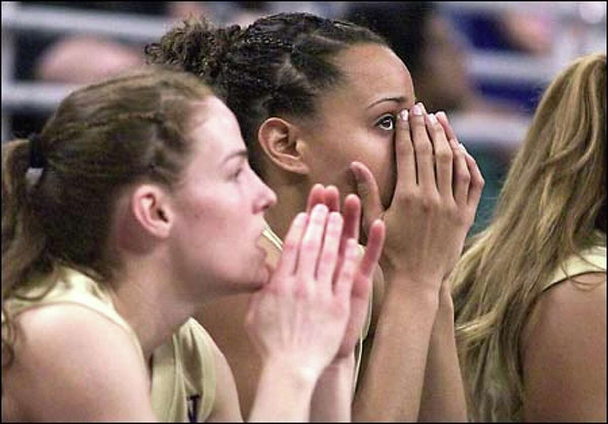 Huskies Jill Pimley and Emily Autrey watch anxiously as their team takes the last inbound in the game's final moments.