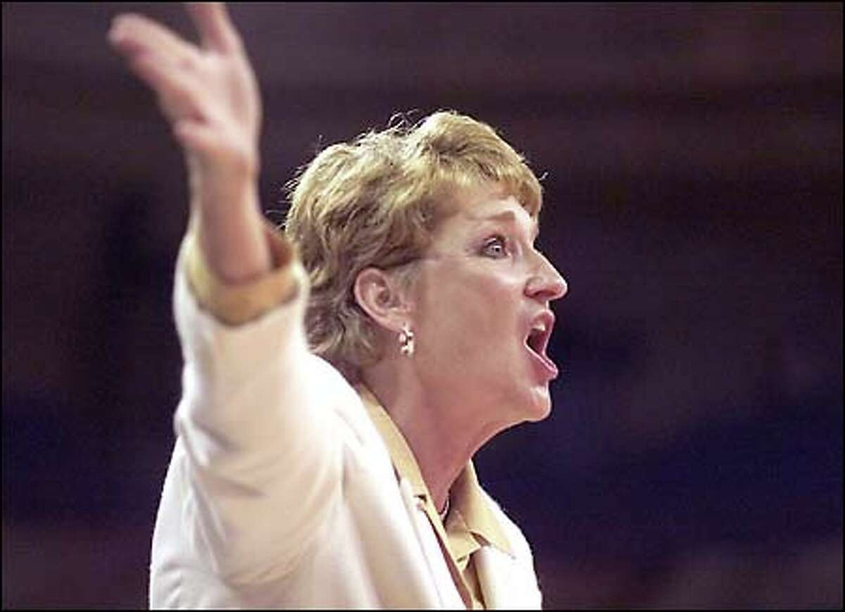 UW coach June Daugherty yells directions during the second half.