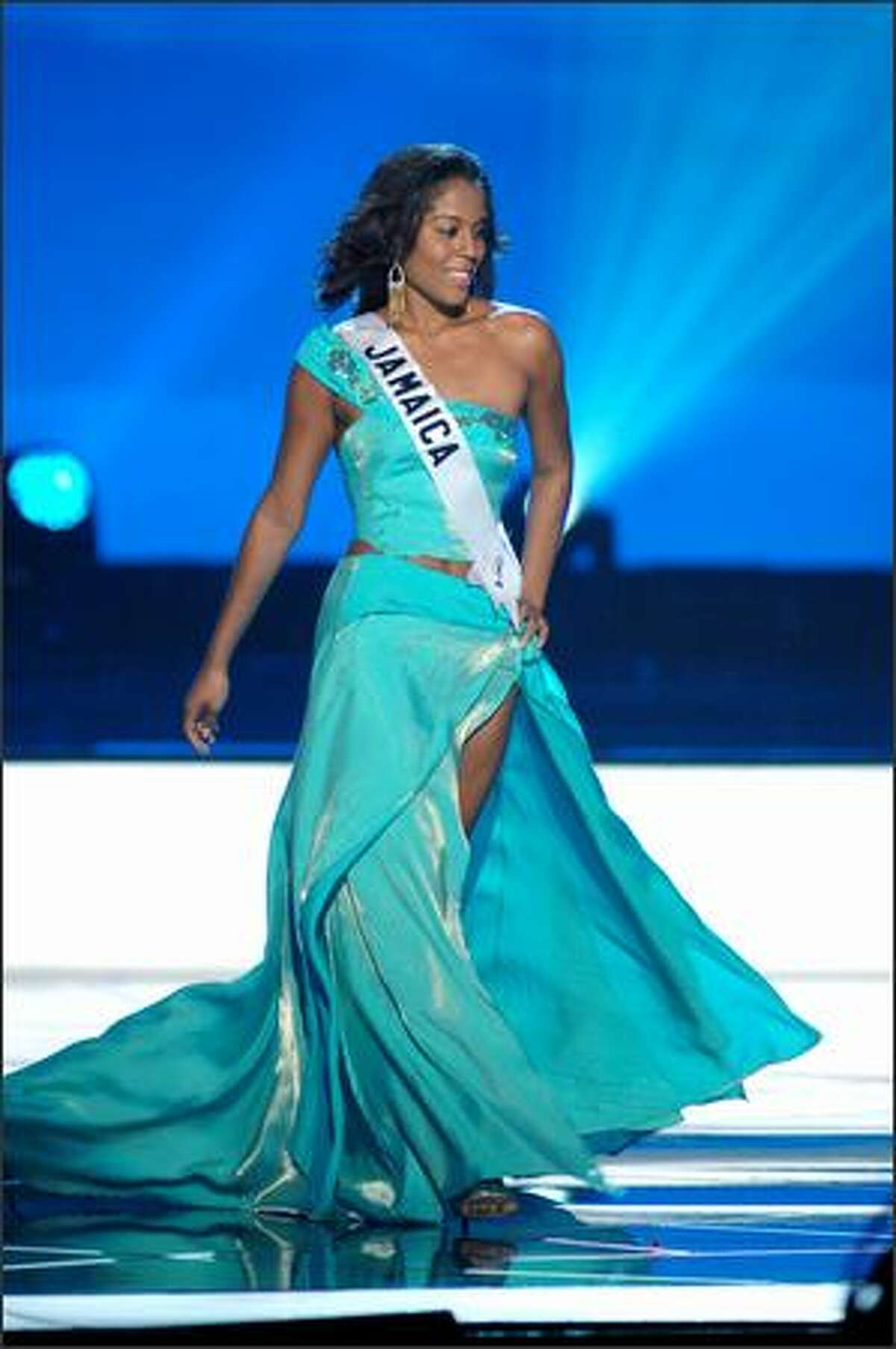 Raquel Wright, Miss Jamaica, competes in an evening gown of her choice during the 2005 Miss Universe Presentation Show at Impact Arena, Exhibition and Convention Center in Bangkok, Thailand on May 26. During the presentation show, each contestant was judged by a preliminary panel of six judges in swimsuit and evening gown categories, after two days of one-on-one interviews. The scores will be tallied and the top 15 contestants will be announced during Monday's telecast (NBC, tape-delayed to 9 p.m. PDT), at the conclusion of which a winner will be crowned.